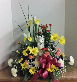 11.75 inch Angel w/fresh arrangement